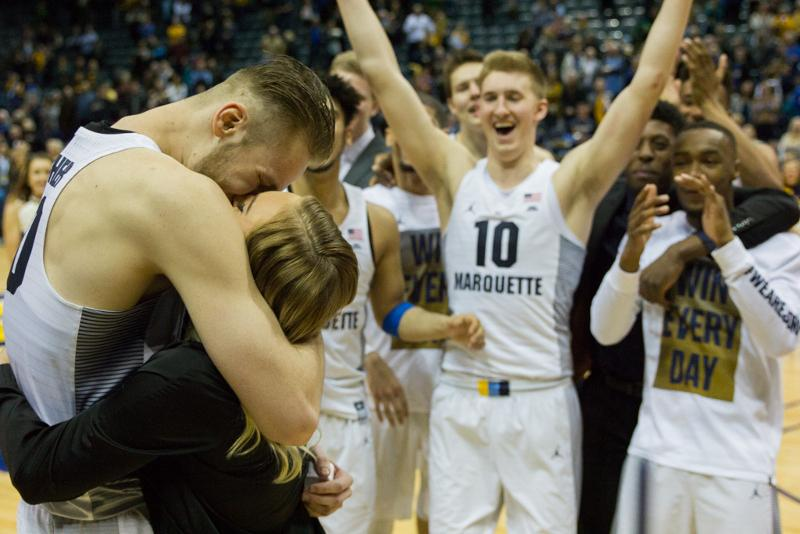 Luke+Fischer+and+Payton+Brock+embrace+after+the+Marquette+center+proposed+Saturday.