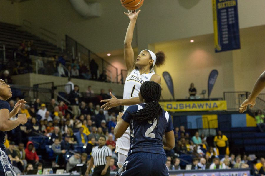 Sophomore+guard+Danielle+King+posted+14+points+and+11+assists+to+lead+the+way+for+Marquette.