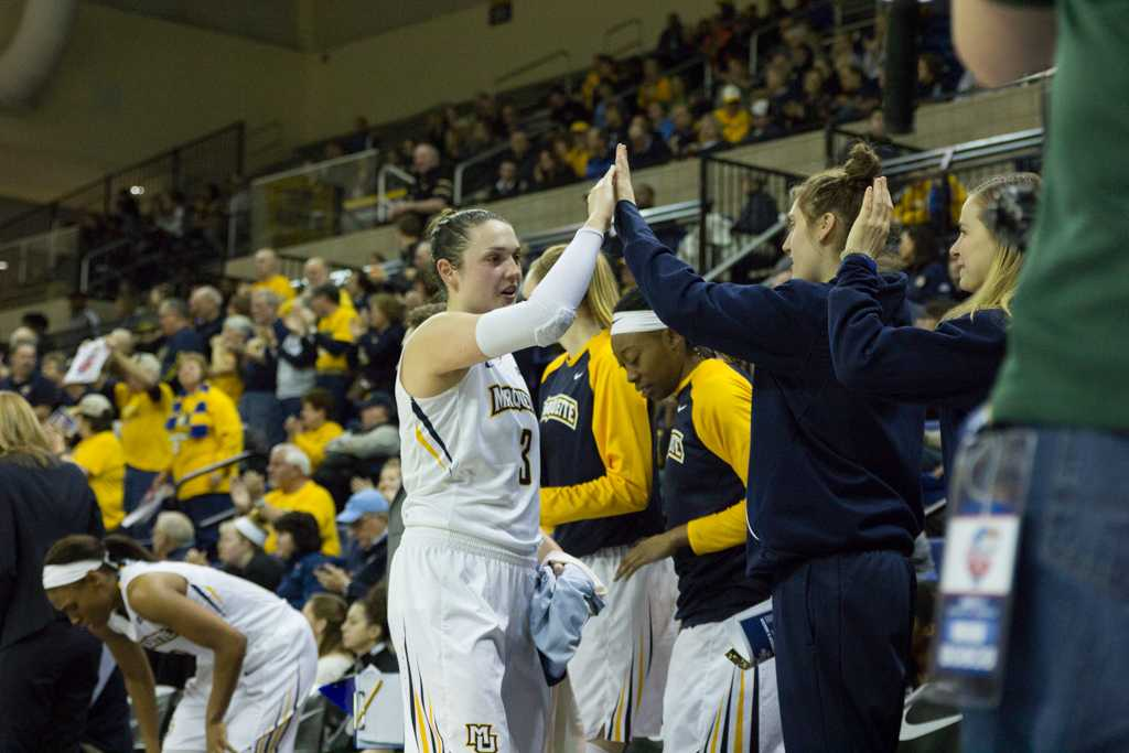Senior McKayla Yentz celebrates with teammates after Marquette's 80-66 victory against Georgetown in the BIG EAST Quarterfinals.