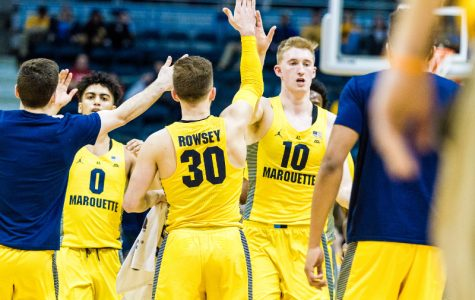Marquette celebrates by the bench during a game against St. John's this season.