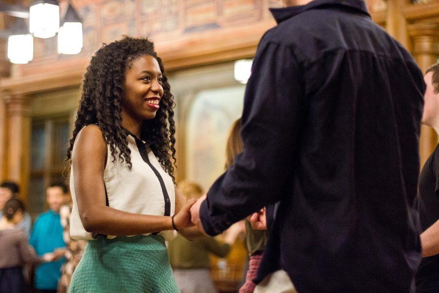 A dancer at Cream City Swing grasps her partners hand.