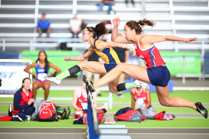 Monique Felix participates in the hurdles at the BIG EAST Championship.