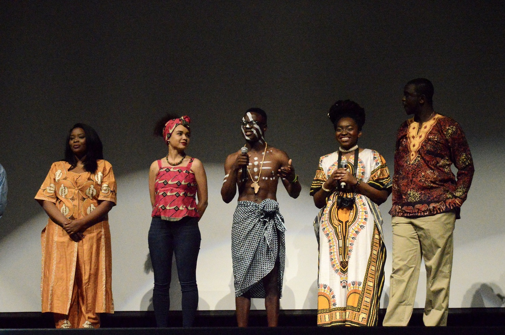 Mr. and Ms. Africa competitors speak at the pageant.