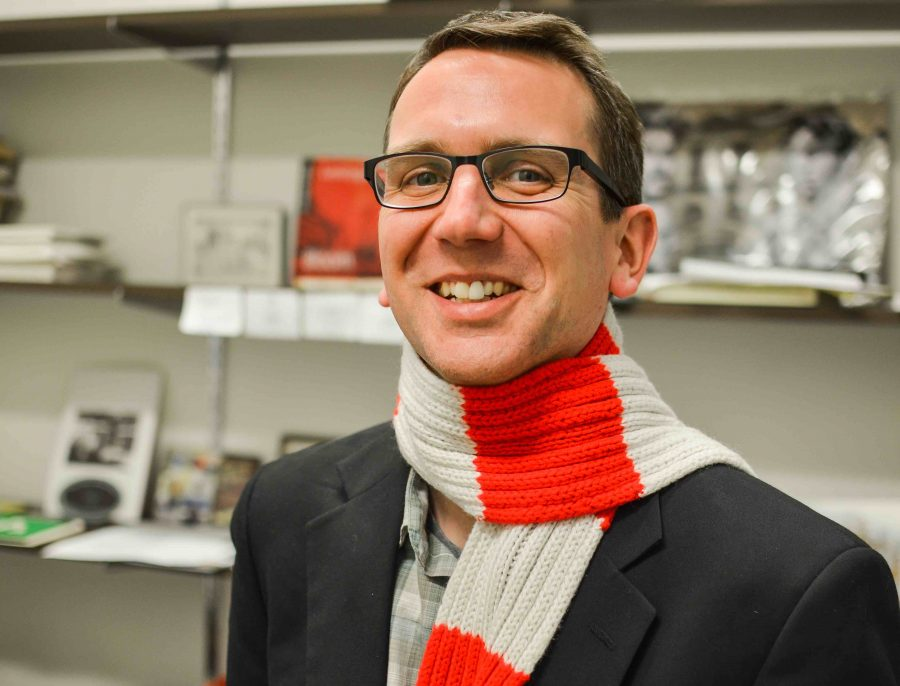 English+professor+Tyler+Farrell+is+known+on+campus+as+%22the+man+with+the+red+scarf.%22+Photo+by+Matthew+Serafin+matthew.serafin%40marquette.edu