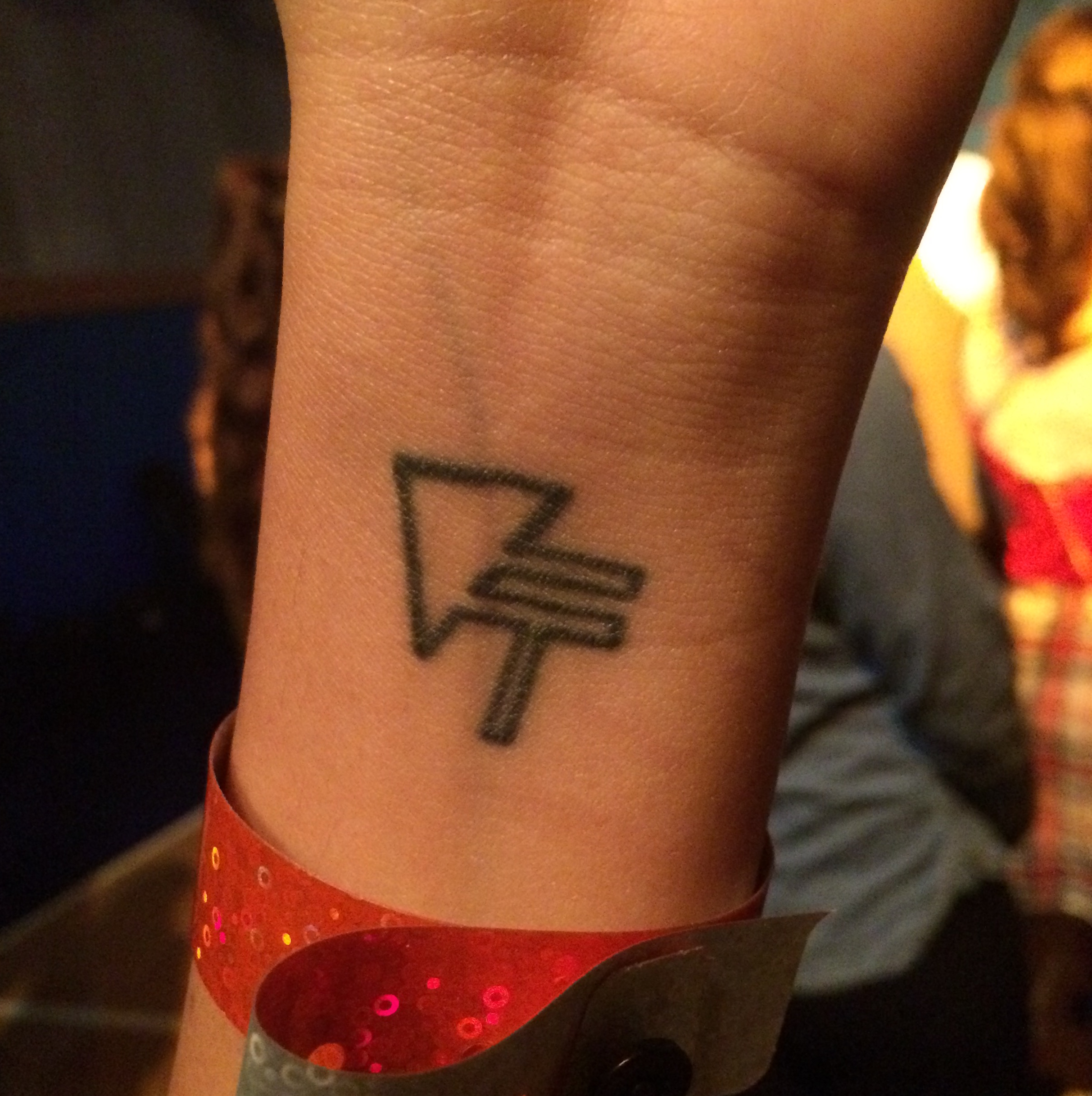 Victoria Fortune, who flew from Texas to see the show on Saturday, fell in love with Vinyl Theatre in 2014 and got their logo tattooed on her wrist. Photo by Jennifer Walter jennifer.walter@marquette.edu