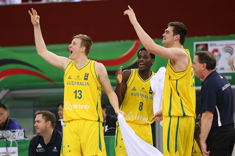 Harry+Froling+%28left%29+celebrates+a+3-point+shot+from+the+sidelines+while+playing+with+Australia.