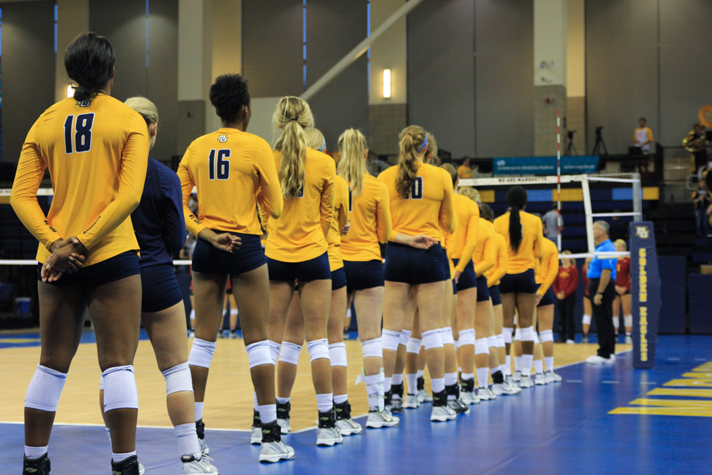The+volleyball+team+lines+up+for+the+anthem+at+the+Marquette+Invitational+tournament.