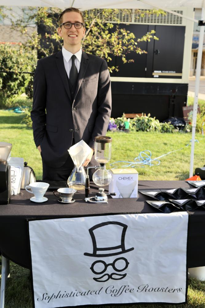 Brendan Nemeth at the Near West Side Farmer's market booth for his company, Sophisticated Coffee Roasters.