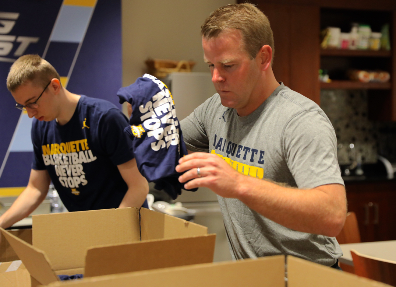 Cole+Bovard+a+sophomore+in+the+College+of+Arts+%26+Sciences+and+coach+Steve+Wojciechowski+send+supplies+to+victims+in+Houston.+%0A%0APhoto+courtesy+of+Marquette+Athletics+
