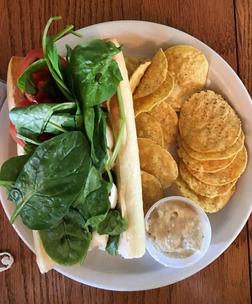 Caprese sandwich with chips and house-made hummus