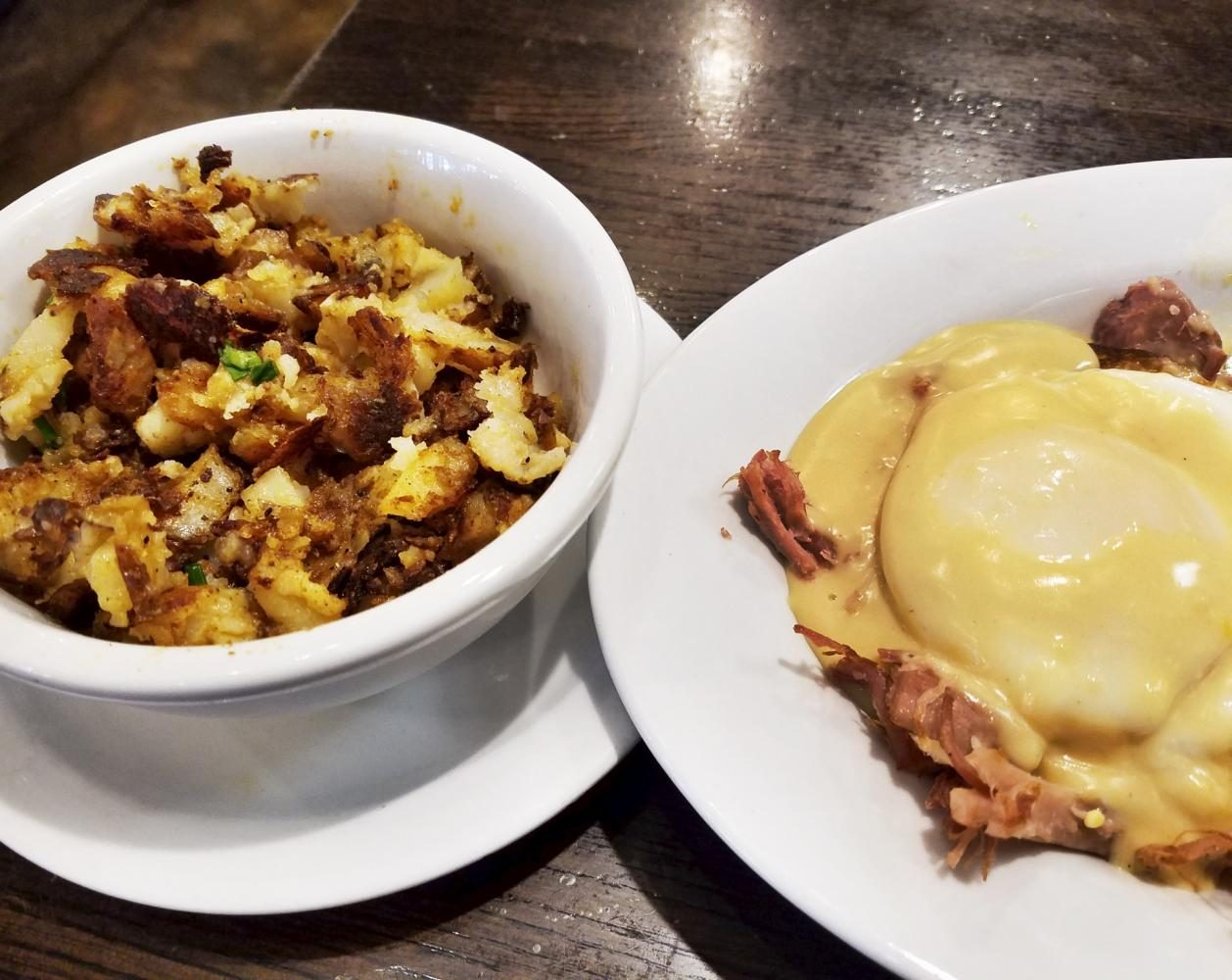 Mad Rooster Cafe's Eggs Benedict and potatoes