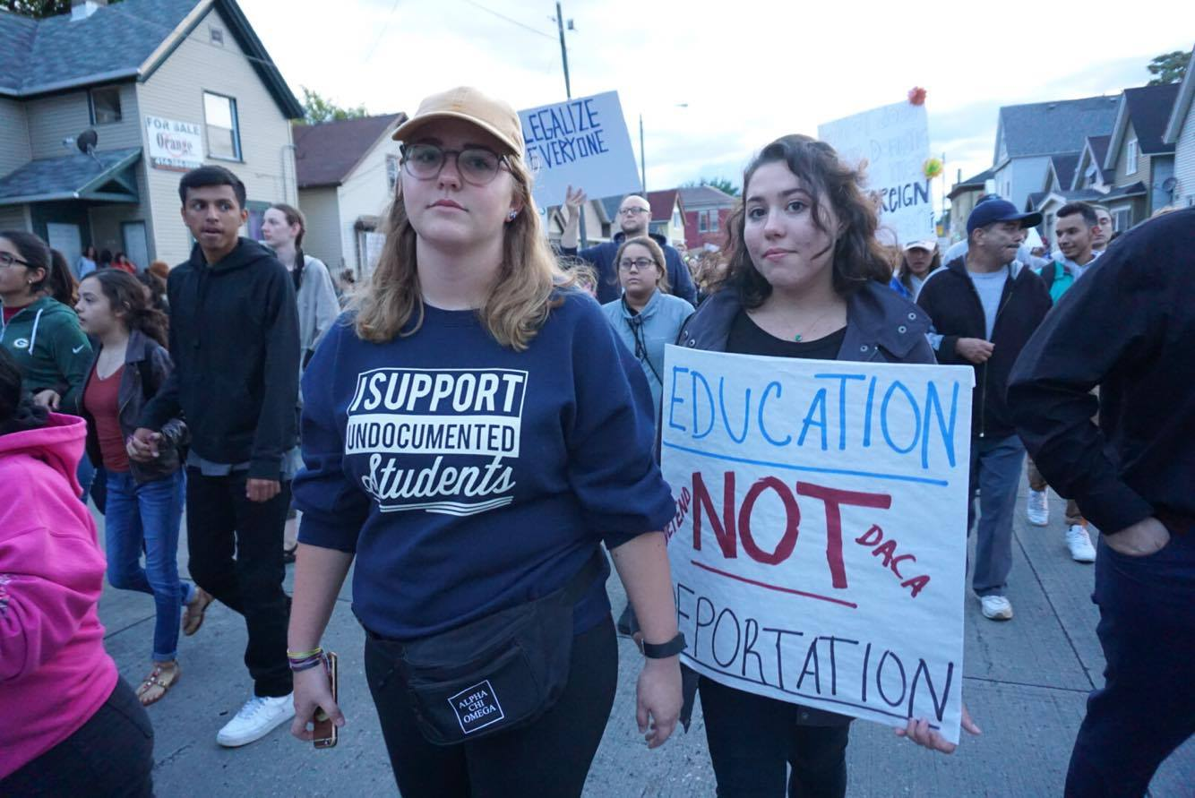 Students Mary Claire Burkhardt (left) and Nina Gary (right) participate in the march. Photo courtesy of Abby Ng.
