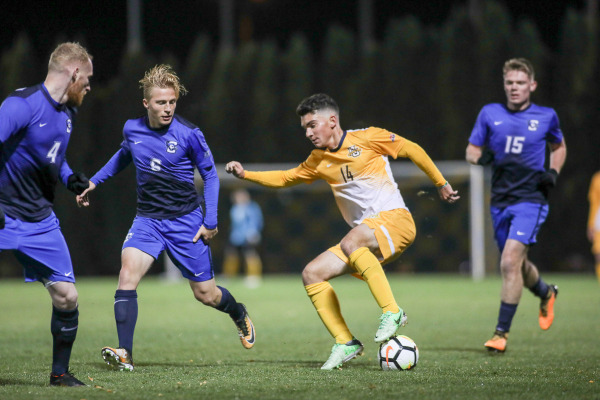 Luka Prpa attempts to dribble around three Creighton defenders in Marquettes 4-3 thriller Wednesday night. Prpa tied a program record with four assists.