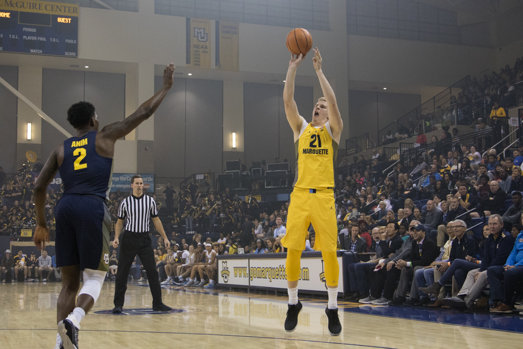 Transfer Harry Froling attempts a three-pointer. He will make his debut tonight against Northern Illinois.
