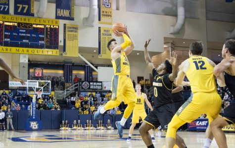 Senior Andrew Rowsey elevates for a three-pointer in the preseason scrimmage against UW-Milwaukee.