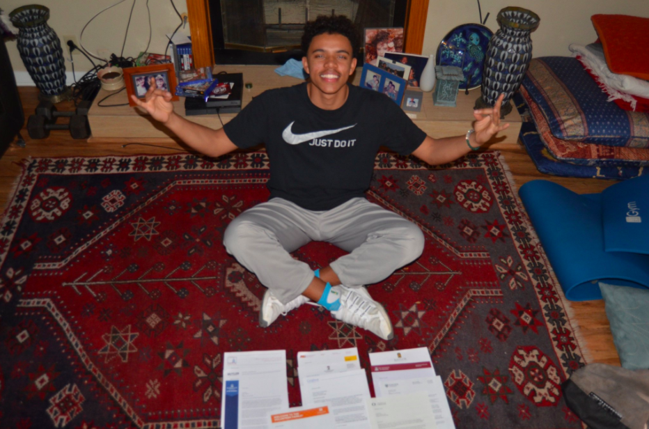 Jacob+Rose+poses+with+a+stack+of+college+acceptance+letters.+Rose+tried+out+for+Marquette%27s+basketball+team+as+a+walk-on.+%28Photo+courtesy+of+Jacob+Rose.%29