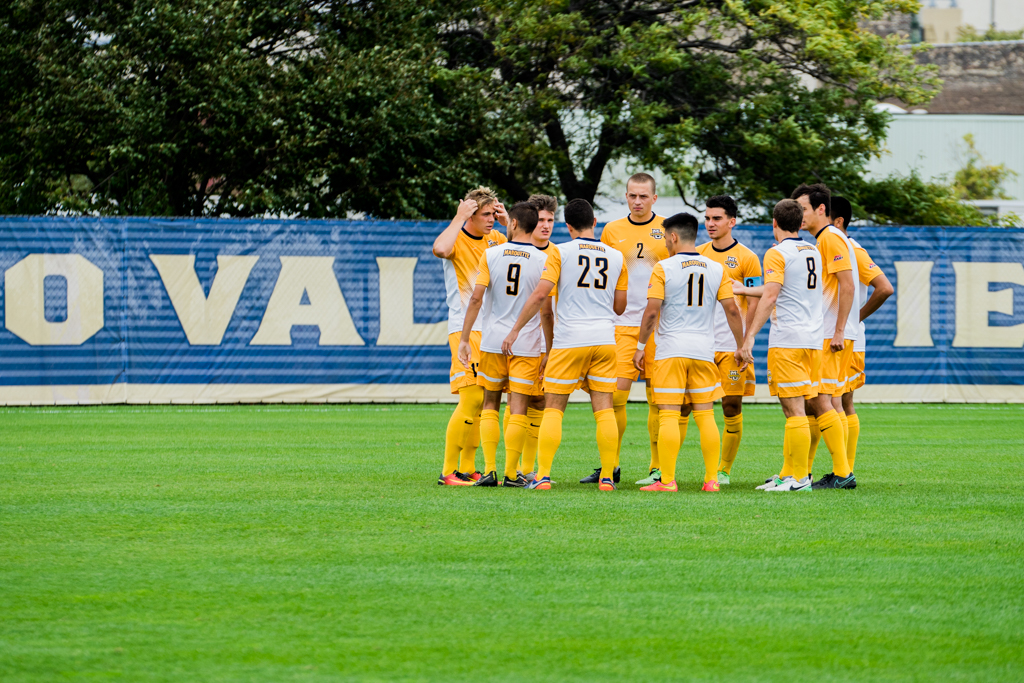 Marquette men's soccer starters gather around before their match against Providence. The Golden Eagles have yet to play the same starting XI this season due to injuries.