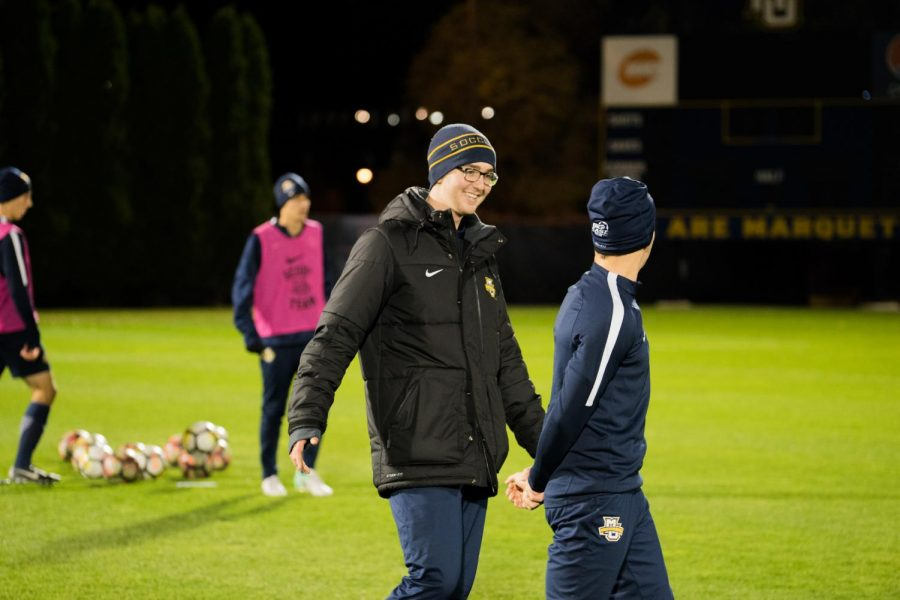 Danny Jarosz (center) talks to student manager Michael Gallo during an evening practice. Jarosz is in charge of filming every match and submitting it to InStat for a film breakdown.