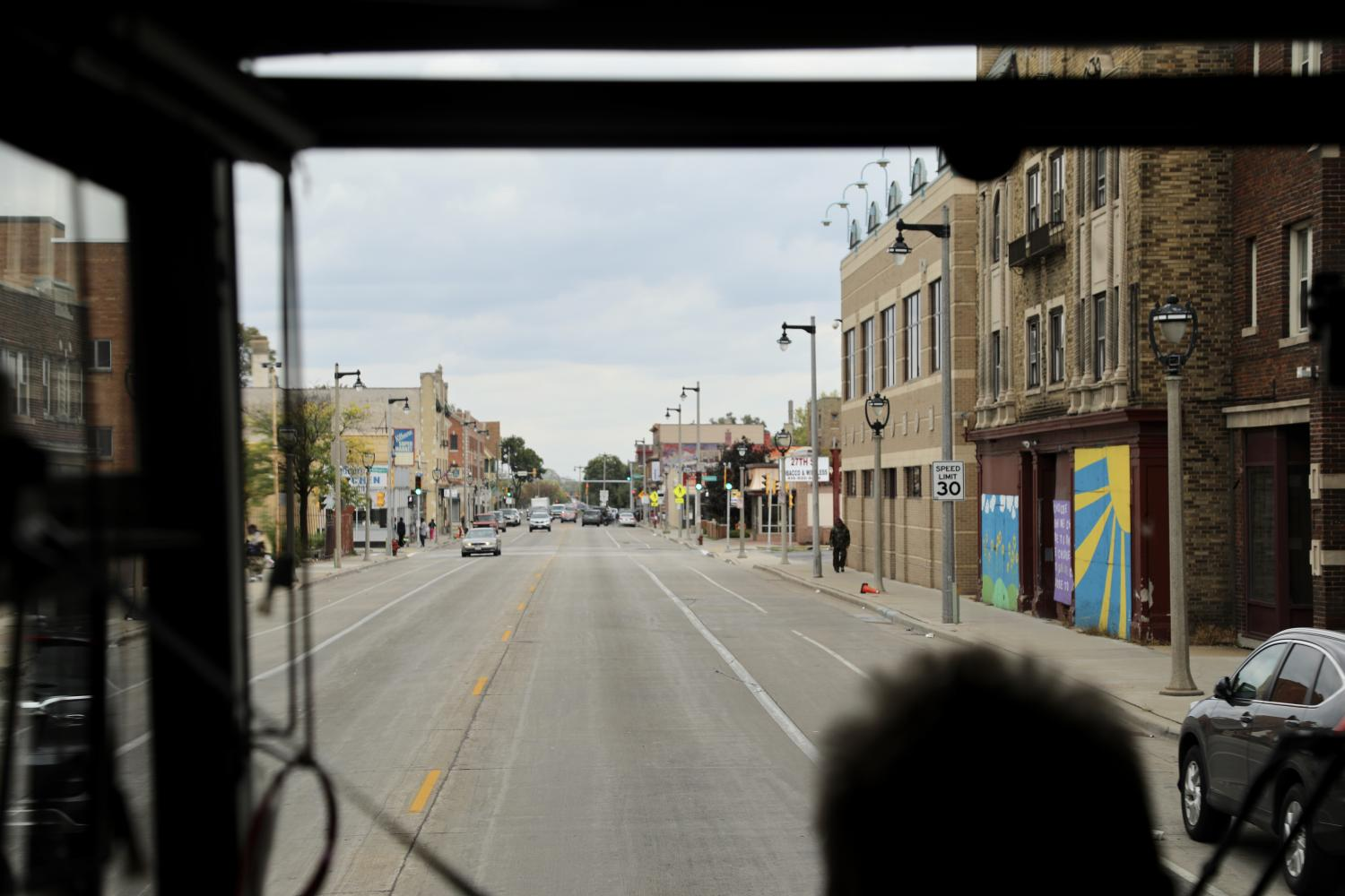 The view out the front window of the bus headed down a street in the Near West Side.