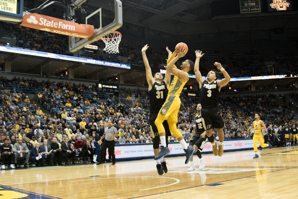 Haanif Cheatham fights off a Purdue double-team. He will leave Marquette effective immediately.
