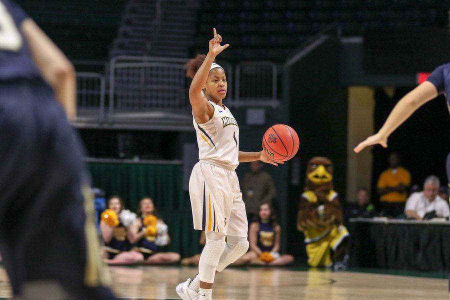 Point guard Danielle King sets the offense during Marquette's NCAA Tournament game against Quinnipiac last season.