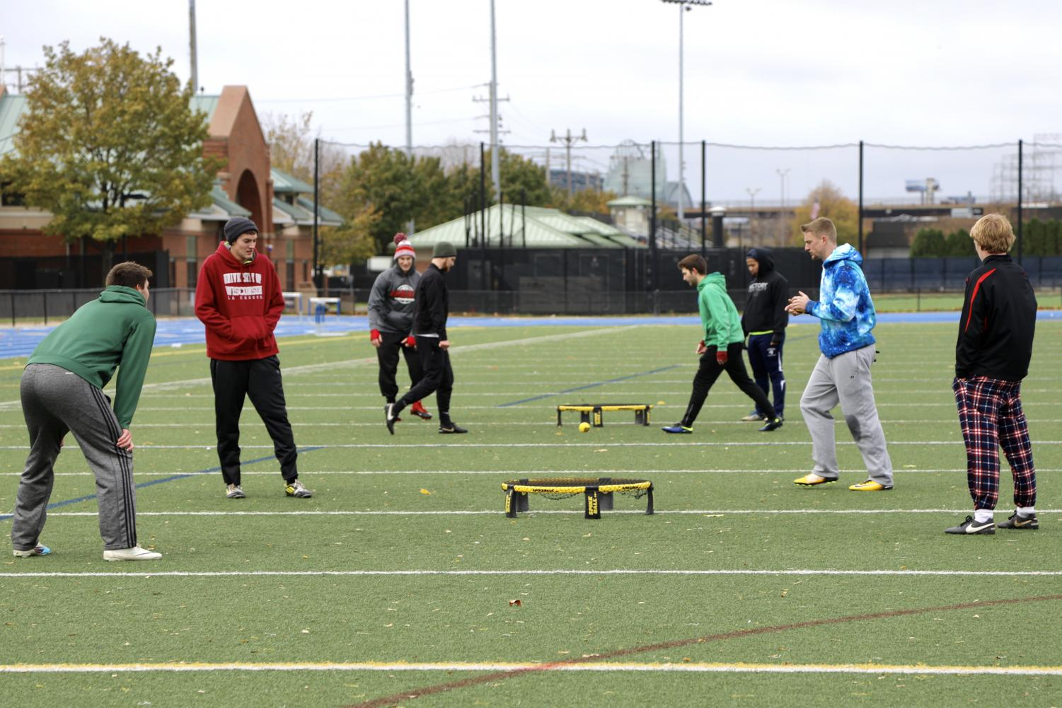 Teams from around Milwaukee compete in Marquette's inaugural spikeball tournament at Valley Fields.