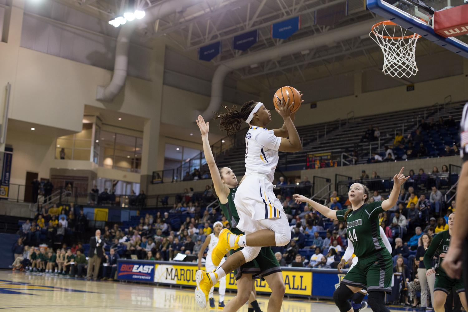 Allazia Blockton goes for a layup against Loyola Maryland. The Golden Eagles open its BIG EAST schedule tonight against St. John's.