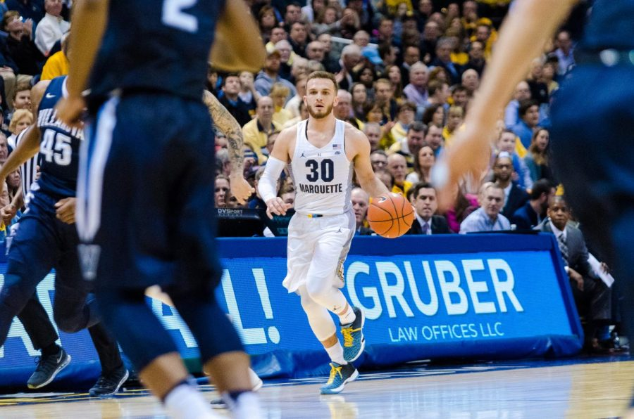 Andrew+Rowsey+brings+the+ball+up+the+court+in+last+year%27s+upset+of+then-No.1+Villanova.