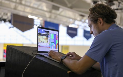 Video coordinator Rob Carver works in the upper levels of the Bradley Center. (Photo by Maggie Bean via Marquette Athletics.)