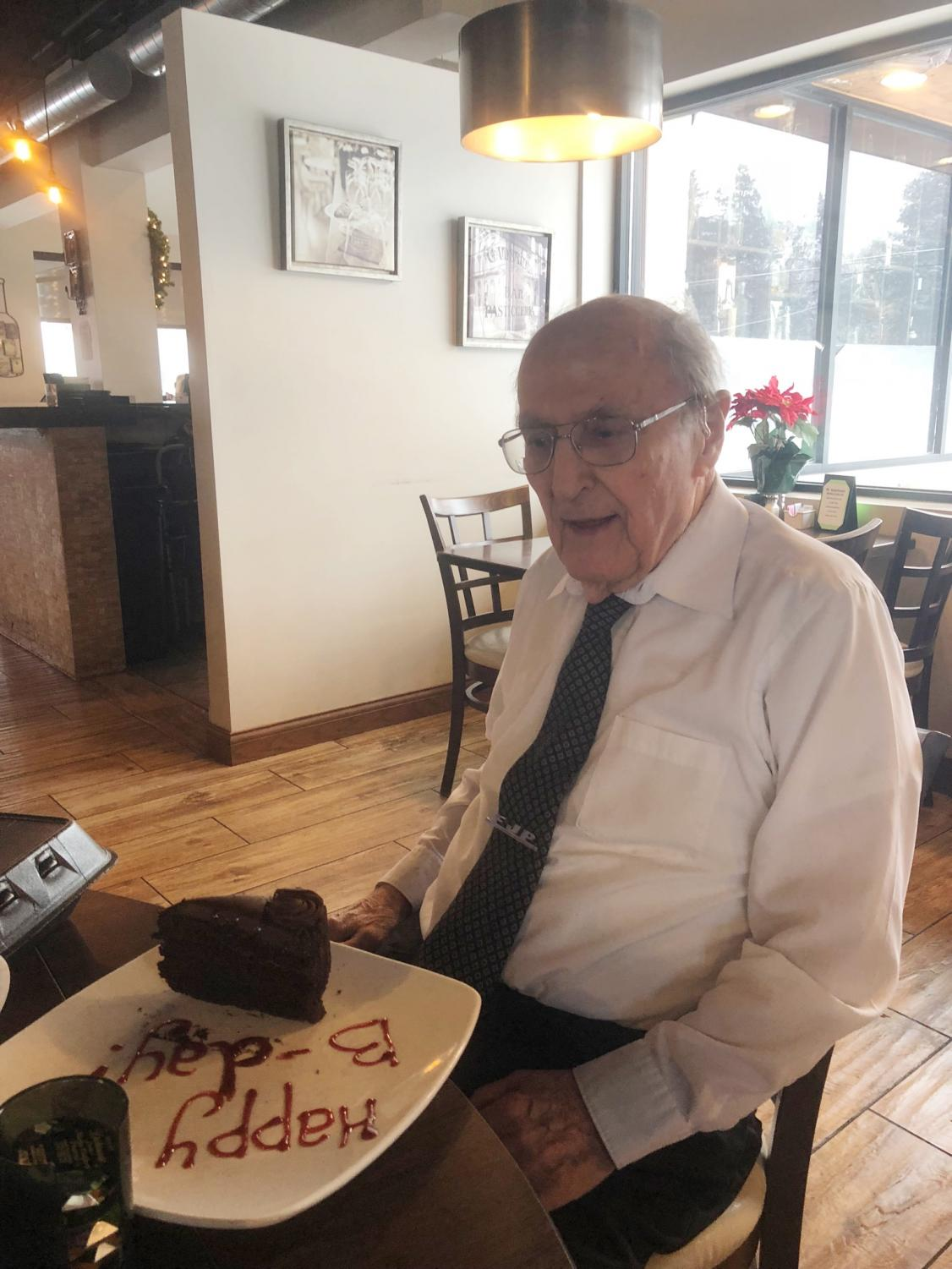 Lisa Durrant's grandfather, Frank Pankanin, seated for birthday breakfast after his festive walk to the table.