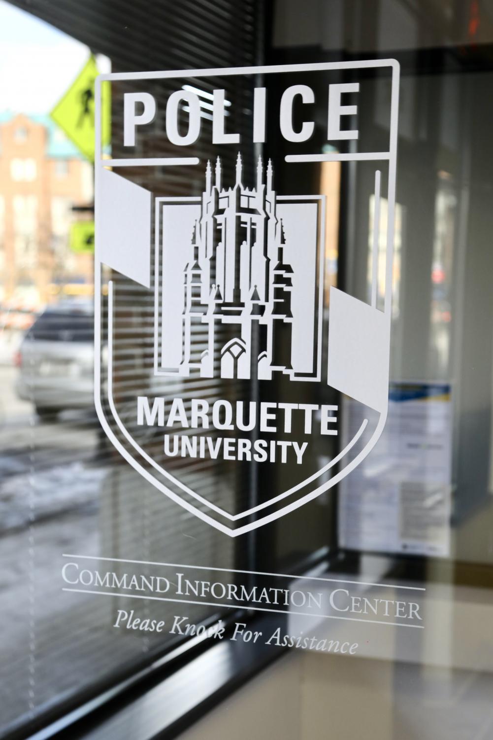 Two suspects robbed a Marquette-affiliated victim of his wallet and phone, leaving him injured.