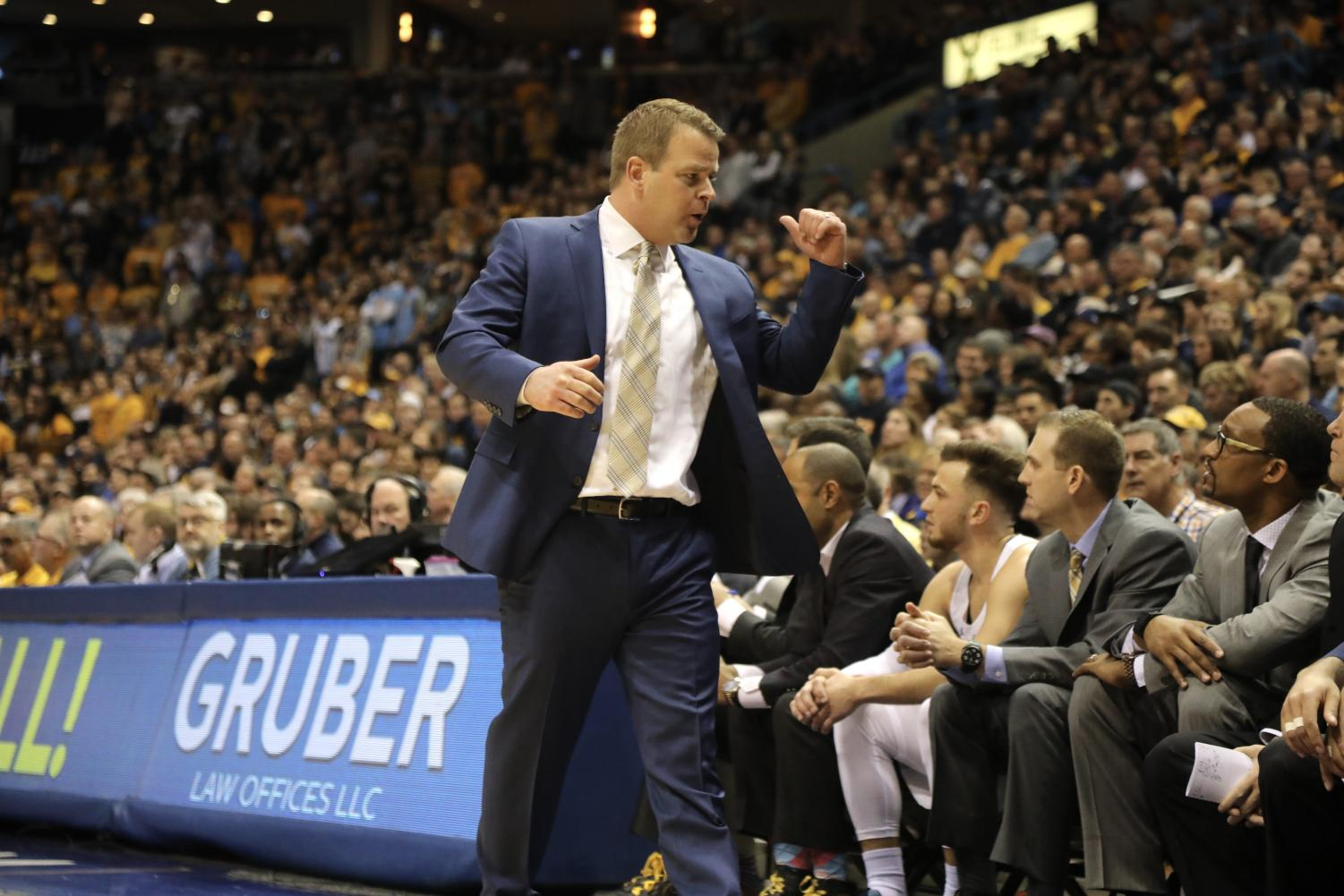 Marquette head coach Steve Wojciechowski doesn't think he'll ever wear a live microphone during a game.