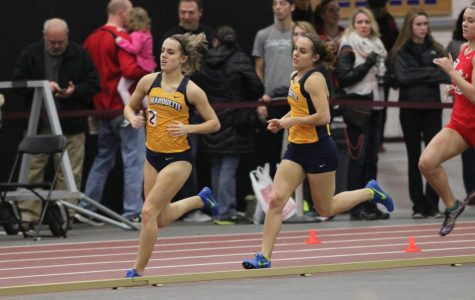 Jennifer and Jessica Parker compete in a relay race. (Photo courtesy: Maggie Bean/Marquette Athletics)