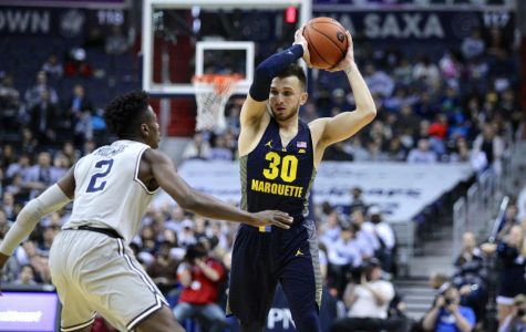Marquette downs Georgetown in overtime, keeps tourney hopes alive