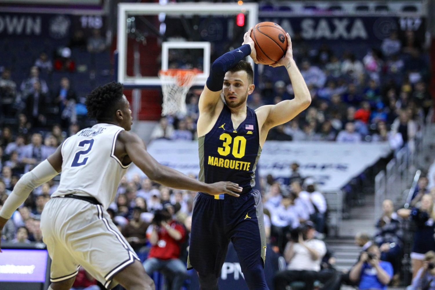 Andrew Rowsey scored 28 points and dished 10 assists in Marquette's win over Georgetown.
