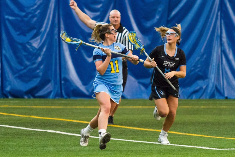 Defender+Kaitlyn+Viviano+prepares+to+pass+the+ball+in+last+year%27s+game+against+Johns+Hopkins.
