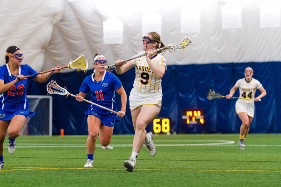 Sophomore Megan Menzuber advances the ball up the field against Florida.