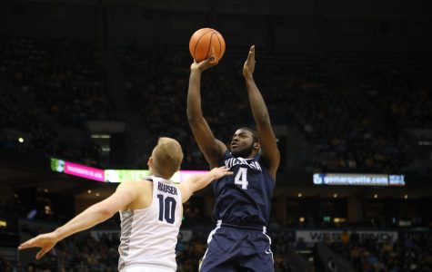 Villanova's Eric Paschall rises up for a jumper over Marquette's Sam Hauser.