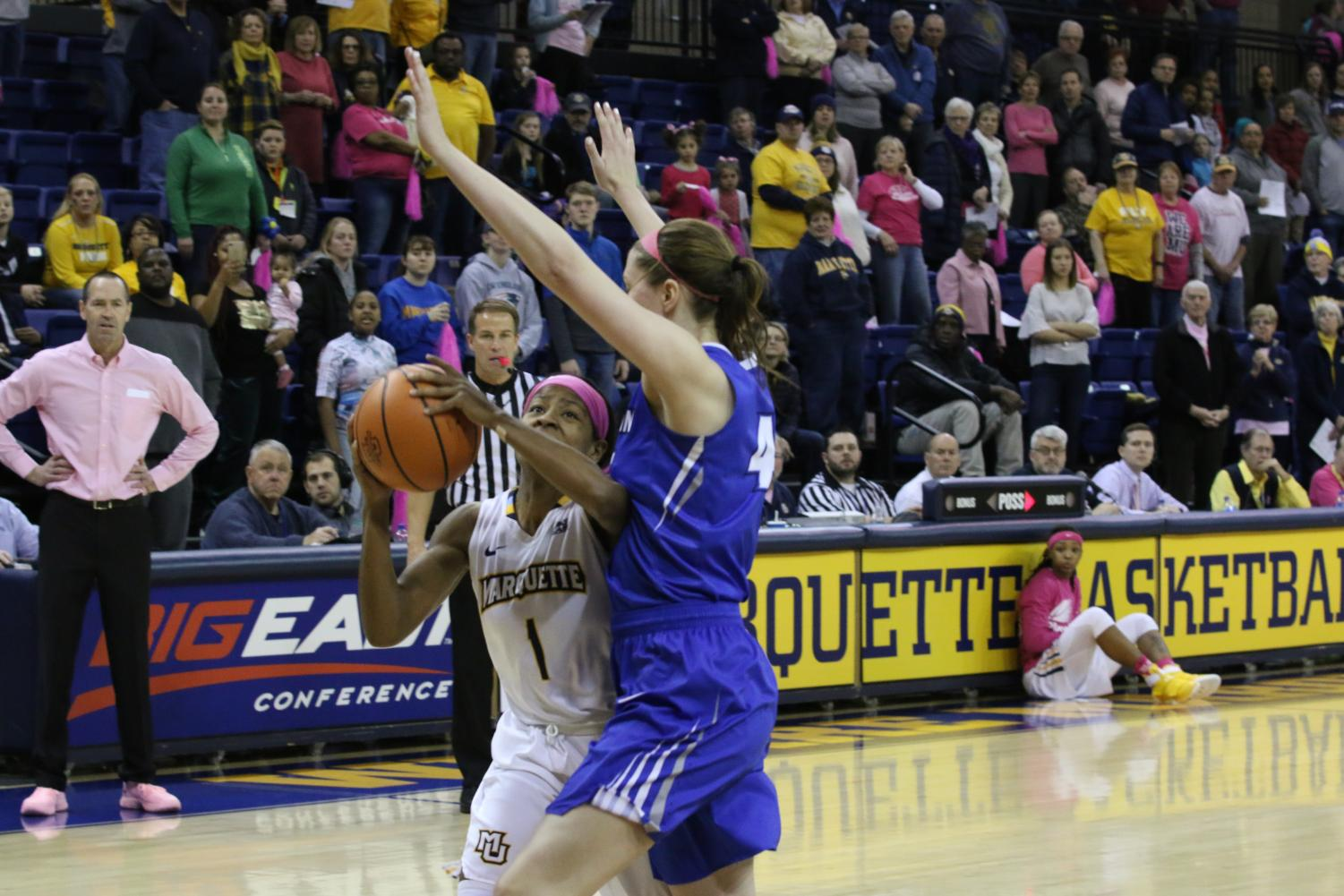 Junior Danielle King goes up for a shot under duress from the Creighton defense.