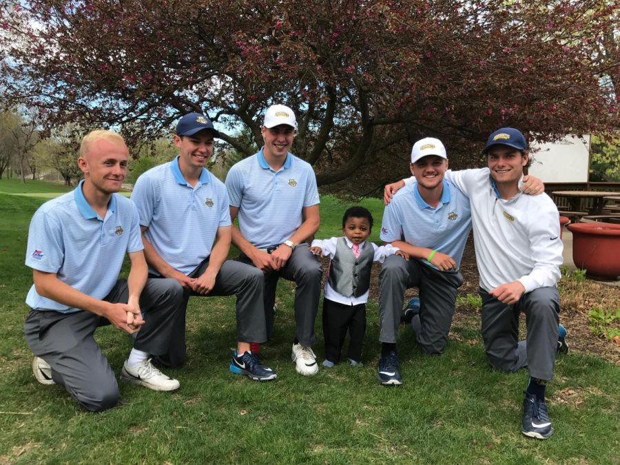 Christian Bailey, Steve's adopted son, poses with the men's golf team. (Photo courtesy of Steve Bailey.)