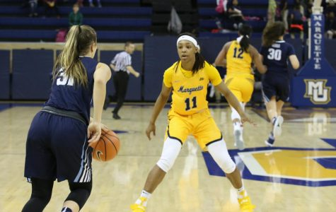 Allazia Blockton defends Villanova's Adrianna Hahn in Marquette's victory over the Wildcats.