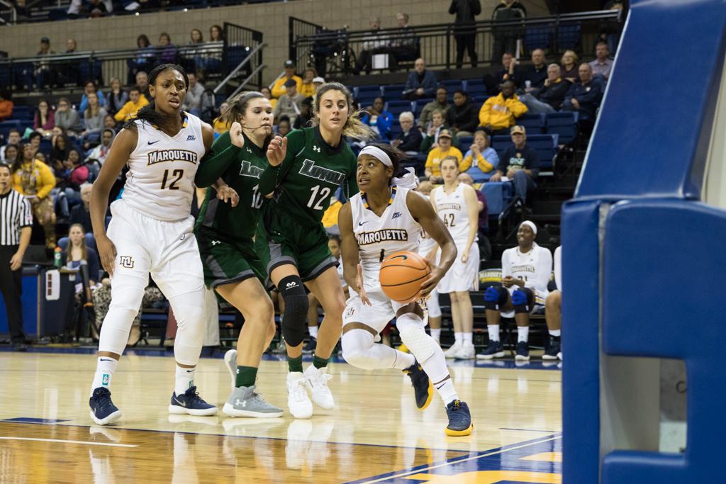 Danielle King drives the baseline against Loyola Maryland.
