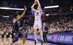 FLOOR SLAPS: Marquette wins first game without Howard with ease