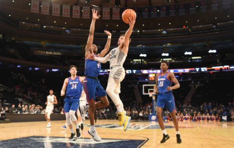 Andrew Rowsey scored 25 points to lead Marquette to a narrow victory over DePaul in the BIG EAST Tournament. (Photo courtesy of Maggie Bean/Marquette Athletics.)