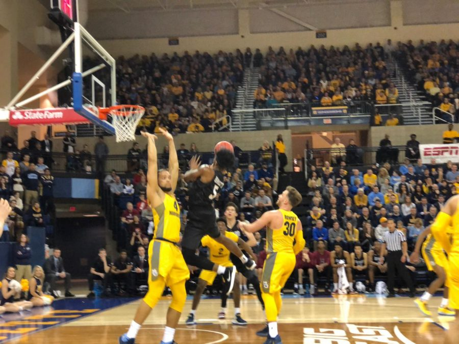 Marquette blanketed Harvard all night, forcing 22 turnovers.