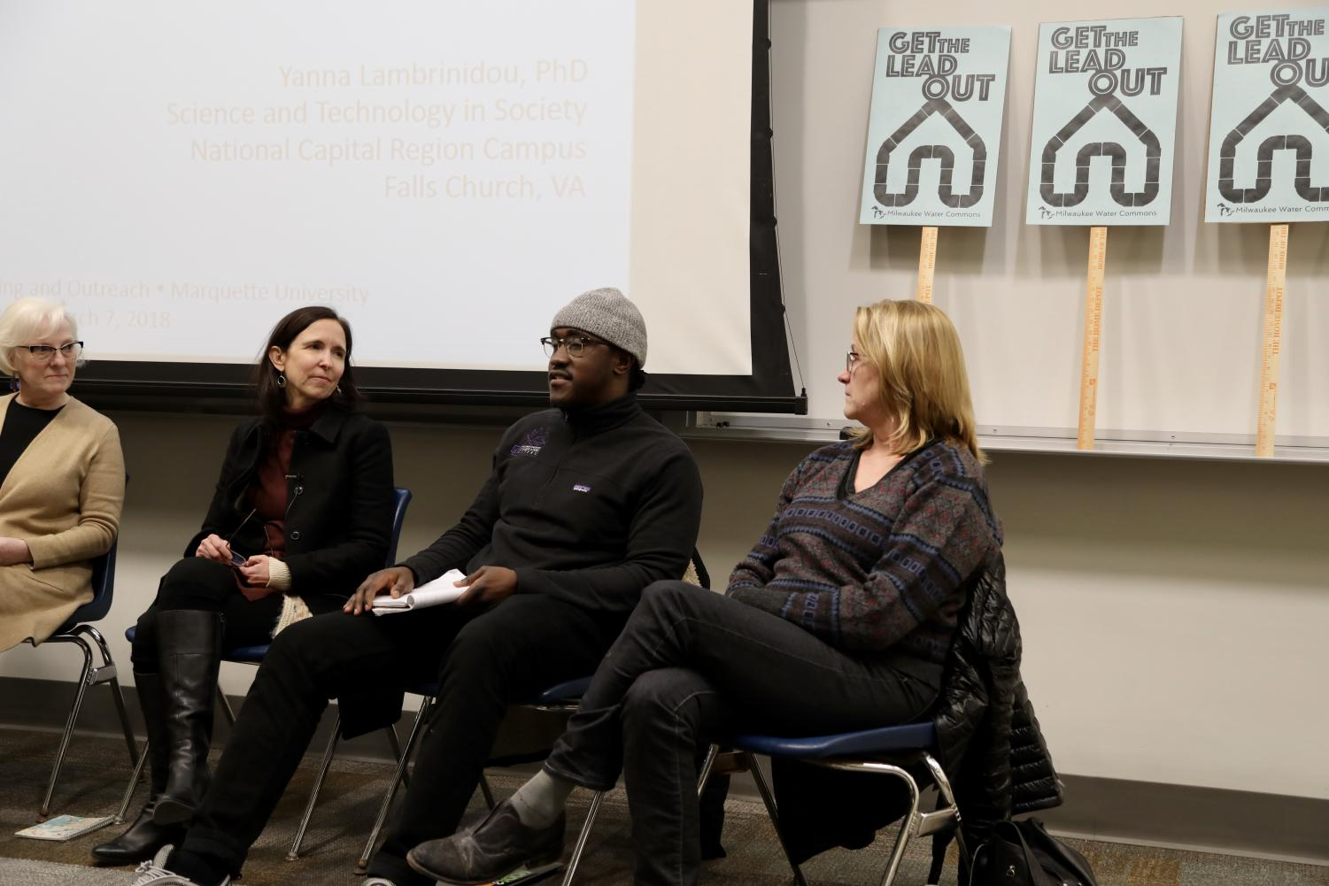 From left to right, panelists Christine Hill, Yanna Lambrinidou, George Olufosoye and Sherrie Tussler engage in a panel discussion about lead service lines in Milwaukee.