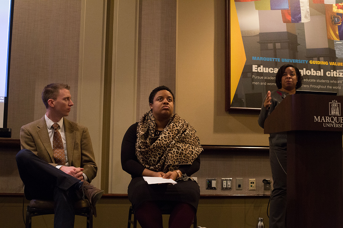 Conor Kelly, an assistant professor of theology, and Monique Liston, an adjunct instructor of Gender and Sexualities Studies participate in a panel discussion.