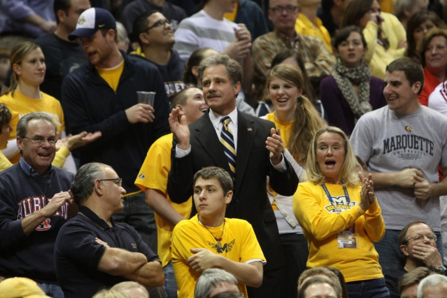 Marquette+alumnus+Rick+Smith+jumps+at+every+game+when+the+arena+plays+the+song+%22Jump+Around.%22+%28Photo+courtesy+of+Marquette+Athletics.%29