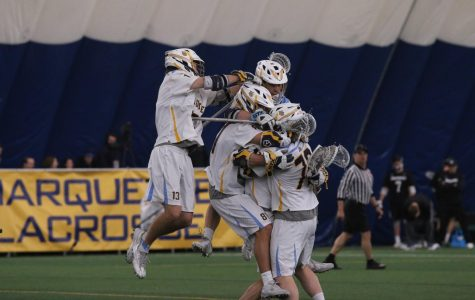 The men's lacrosse team celebrates John Wagner's game-winning goal. Marquette now has 21 one-goal wins in program history.