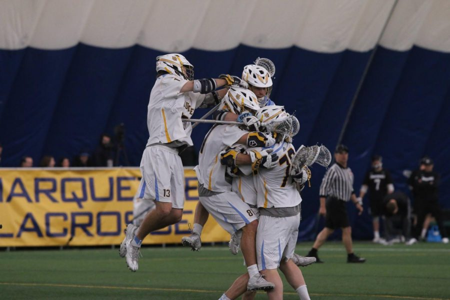 The+men%27s+lacrosse+team+celebrates+John+Wagner%27s+game-winning+goal.+Marquette+now+has+21+one-goal+wins+in+program+history.